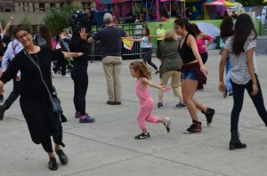 Rosedale student copies the action of a younger FluxDelux participant at PANAMANIA, August 2015.